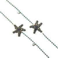 Collana lunga tataborello perline verde menta e stelle marine in ematite ricamate a mano